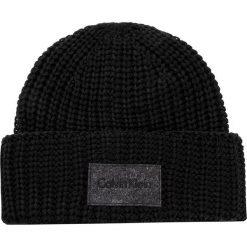 Czapka CALVIN KLEIN - Ingmar Hat K50K503236 001. Czarne czapki damskie Calvin Klein, z materiału. W wyprzedaży za 169,00 zł.