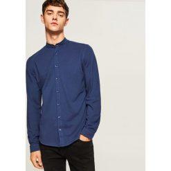 Koszula slim fit z łatami na łokciach - Granatowy. Niebieskie koszule męskie na spinki marki Reserved. Za 119,99 zł.