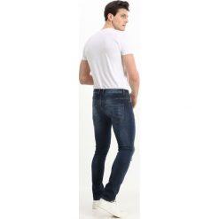 Benetton Jeans Skinny Fit dark blue. Niebieskie rurki męskie marki Tiffosi. Za 199,00 zł.