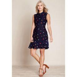 Sukienki hiszpanki: Sukienka rozszerzana, rozkloszowana, krótka, z graficznym wzorem