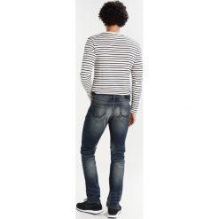 Superdry Jeansy Slim Fit antique vintage. Niebieskie jeansy męskie relaxed fit Superdry, z bawełny. W wyprzedaży za 343,20 zł.