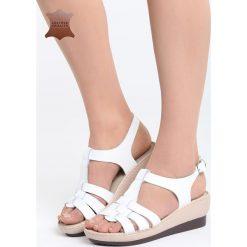 Białe Skórzane Sandały Creature Comforts. Białe sandały damskie marki Born2be, z materiału, na koturnie. Za 99,99 zł.