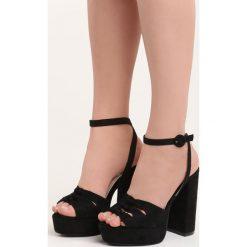 Czarne Sandały Fallon. Czarne sandały damskie na słupku Born2be, w paski, na wysokim obcasie. Za 59,99 zł.