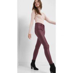 Dopasowane spodnie. Żółte rurki damskie marki Orsay, s, z bawełny, z golfem. Za 79,99 zł.