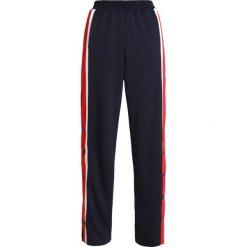 Replay PANTS Spodnie treningowe dark blue. Niebieskie bryczesy damskie marki Replay. Za 559,00 zł.