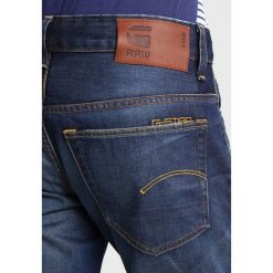 GStar 3301 LOW TAPERD Jeansy Zwężane hydrite denim. Białe jeansy męskie marki G-Star, z nadrukiem. W wyprzedaży za 375,20 zł.