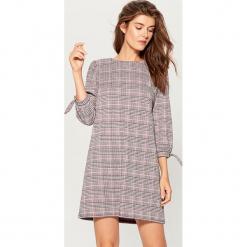 Sukienka mini w kratkę - Różowy. Fioletowe sukienki mini marki Reserved. Za 99,99 zł.