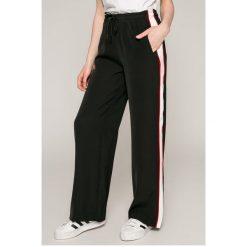 Calvin Klein Jeans - Spodnie. Szare jeansy damskie z wysokim stanem marki Calvin Klein Jeans. W wyprzedaży za 339,90 zł.