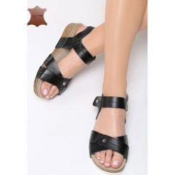 Czarne Skórzane Sandały Behind The World. Czarne sandały damskie marki Born2be, z materiału, na obcasie. Za 99,99 zł.