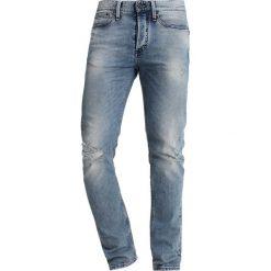 Denham BOLT Jeans Skinny Fit blue denim. Niebieskie rurki męskie Denham, z bawełny. Za 669,00 zł.
