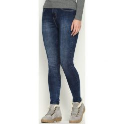 Spodnie damskie: Niebieskie Jeansy Flag
