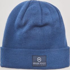 Czapka - Niebieski. Niebieskie czapki zimowe damskie marki INESIS, z elastanu. Za 29,99 zł.