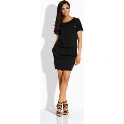 Luźna sukienka z kieszonką czarna ASHLEY. Szare sukienki dresowe marki bonprix, melanż, z kapturem, z długim rękawem, maxi. Za 94,89 zł.
