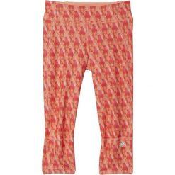 Spodnie dresowe damskie: Adidas Spodnie damskie Supernova 3/4 Tight pomarańczowe r. XS (AI3274)