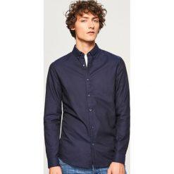 Koszula z bawełny oxford slim fit - Granatowy. Niebieskie koszule męskie slim marki Reserved, l, z bawełny. Za 99,99 zł.