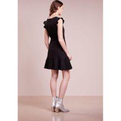 Emporio Armani Sukienka z dżerseju black. Czarne sukienki z falbanami marki Emporio Armani, z bawełny. W wyprzedaży za 524,50 zł.