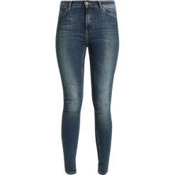 Denim is Dead OATH  Jeans Skinny Fit mid blue wash. Niebieskie rurki damskie Denim is Dead. Za 389,00 zł.