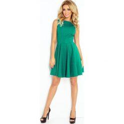 125-6 sukienka koło - dekolt łódka - cegiełka - zielona. Zielone sukienki marki numoco, l, z dekoltem w łódkę, oversize. Za 112,00 zł.