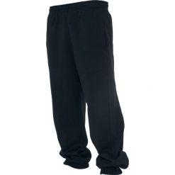 Urban Classics Sweatpants Spodnie dresowe czarny. Niebieskie spodnie dresowe męskie marki Urban Classics, l, z okrągłym kołnierzem. Za 121,90 zł.