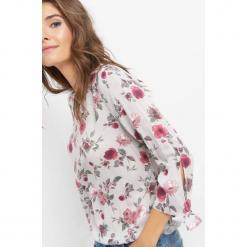 Bluzka w kwiaty. Szare bluzki asymetryczne Orsay, w kwiaty, z tkaniny. Za 69,99 zł.