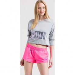 Puma - Bluza. Różowe bluzy z nadrukiem damskie marki Puma, m, z dzianiny, bez kaptura. W wyprzedaży za 99,90 zł.