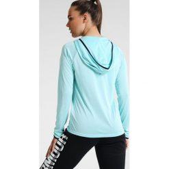 Under Armour TECH TWIST Koszulka sportowa blue infinity. Niebieskie topy sportowe damskie marki Under Armour, s, z elastanu. W wyprzedaży za 141,75 zł.