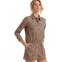 Kombinezon w kolorze beżowym ze wzorem. Brązowe kombinezony damskie marki Mango, l, z koronki, na ramiączkach. W wyprzedaży za 179,95 zł.