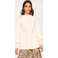 Sweter z niską stójką - Kremowy. Niebieskie swetry klasyczne damskie marki ARTENGO, z elastanu, ze stójką. Za 79,99 zł.