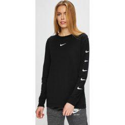 Nike Sportswear - Bluzka. Różowe bluzki nietoperze marki Nike Sportswear, l, z nylonu, z okrągłym kołnierzem. Za 159,90 zł.