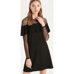 Sukienka z falbaną - Czarny. Czarne sukienki z falbanami Sinsay, l. Za 79,99 zł.