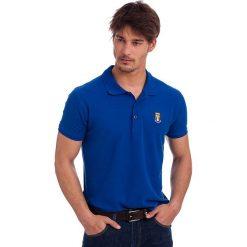 Koszulka polo w kolorze niebieskim. Niebieskie topy sportowe damskie Polo Club, z haftami, z bawełny, z krótkim rękawem. W wyprzedaży za 84,95 zł.