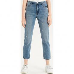 Jeansy slim z wysokim stanem - Niebieski. Niebieskie spodnie z wysokim stanem Sinsay, z jeansu. Za 99,99 zł.