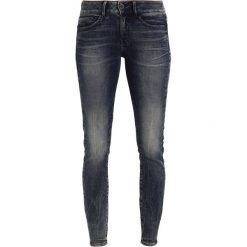 GStar MIDGE DCODY MID SKINNY Jeans Skinny Fit cerro denim. Niebieskie jeansy damskie relaxed fit marki G-Star. W wyprzedaży za 365,40 zł.