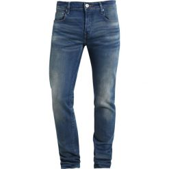 GStar 3301 LOW TAPERED Jeansy Relaxed Fit firro denim. Niebieskie jeansy męskie relaxed fit G-Star. Za 459,00 zł.
