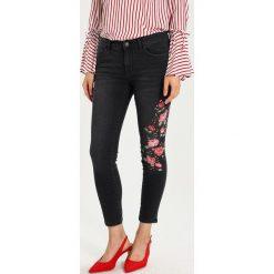 Boyfriendy damskie: Springfield Jeans Skinny Fit black
