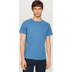T-shirt z drobnym nadrukiem - Niebieski. Niebieskie t-shirty męskie z nadrukiem marki Reserved, l. W wyprzedaży za 24,99 zł.