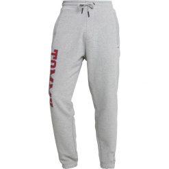 Tommy Jeans ESSENTIAL COLLEGE Spodnie treningowe grey. Szare spodnie dresowe męskie Tommy Jeans, z bawełny. Za 349,00 zł.