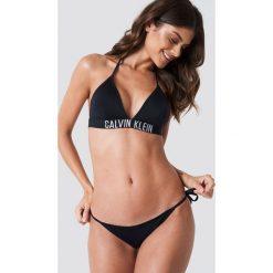 Calvin Klein Dół bikini Cheeky String Side Tie - Black. Czarne bikini marki Calvin Klein. Za 141,95 zł.