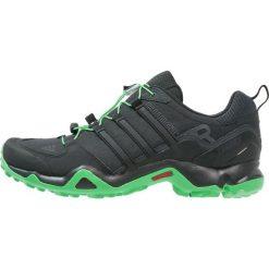 Adidas Performance TERREX SWIFT  Obuwie hikingowe core black/energy. Czarne buty sportowe męskie adidas Performance, z materiału, outdoorowe. W wyprzedaży za 359,20 zł.