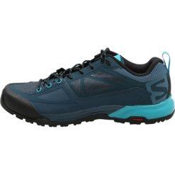 Salomon X ALP SPRY Obuwie hikingowe mallard blue/reflecting pond/blue black. Białe buty sportowe damskie marki Nike Performance, z materiału, na golfa. W wyprzedaży za 396,75 zł.