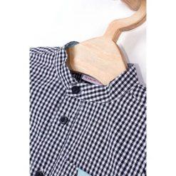 Coccodrillo - Koszula dziecięca 62-86 cm. Białe koszule chłopięce z długim rękawem marki COCCODRILLO, m, z bawełny, z okrągłym kołnierzem. Za 59,90 zł.