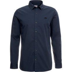 Lacoste LIVE Koszula meridian blue. Niebieskie koszule męskie marki Polo Ralph Lauren, m, z bawełny, polo. Za 379,00 zł.