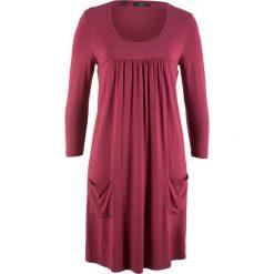 Sukienka shirtowa z rękawami 3/4 bonprix czerwony rododendron. Fioletowe sukienki z falbanami marki bonprix. Za 69,99 zł.