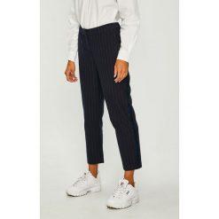 Tommy Jeans - Spodnie. Szare jeansy damskie z wysokim stanem marki Tommy Jeans. Za 449,90 zł.