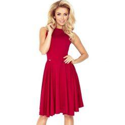 98-9 sukienka koło - dekolt łódka - lacosta bordowa. Czerwone sukienki na komunię marki numoco, l, z dekoltem w łódkę, rozkloszowane. Za 112,00 zł.