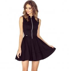 123-12 sukienka z ekspresem z przodu i kieszonkami - drobna lacosta cz. Czarne długie sukienki marki numoco, l, z materiału, z długim rękawem, oversize. Za 131,00 zł.