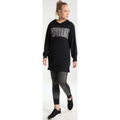 Puma SPARK COVERUP Koszulka sportowa black. Czarne topy sportowe damskie marki Puma, s, z elastanu, z długim rękawem. W wyprzedaży za 146,30 zł.