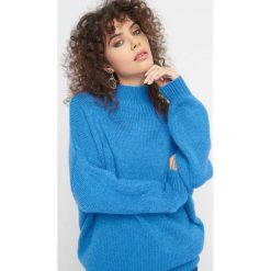 Sweter oversize z golfem. Czarne golfy damskie marki KIPSTA, m, z elastanu, z długim rękawem, na fitness i siłownię. Za 99,99 zł.