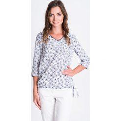 Bluzki asymetryczne: Biała bluzka bombka w kwiaty QUIOSQUE