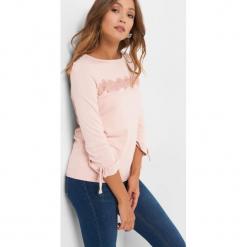 Koszulka z koronkową wstawką. Brązowe t-shirty damskie Orsay, xs, w jednolite wzory, z dzianiny, z falbankami. Za 69,99 zł.